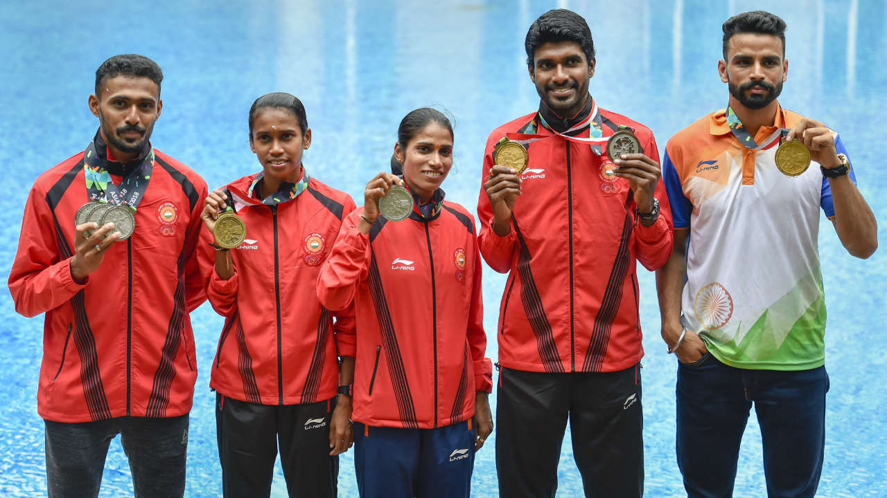 Indian Athletes (L-R) Md. Anas, PU Chitra, Sudha Singh, Jinson Johnson and Arpinder Singh pose for photograph with their medals won at Asian Games. (Image: PTI)