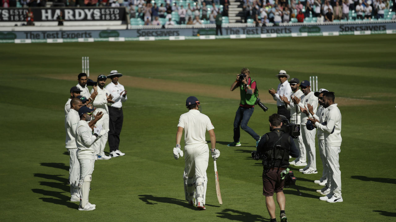 England captain Joe Root won his fifth toss in as many matches and opted to bat first. Root had declared on the eve of the Test that there would be no changes in the England playing XI for the final Test. As England openers Alastair Cook and Keaton Jennings walked out to bat, Cook playing his final Test match, was given a guard of honour by Virat Kohli and his players. (Image - AP)