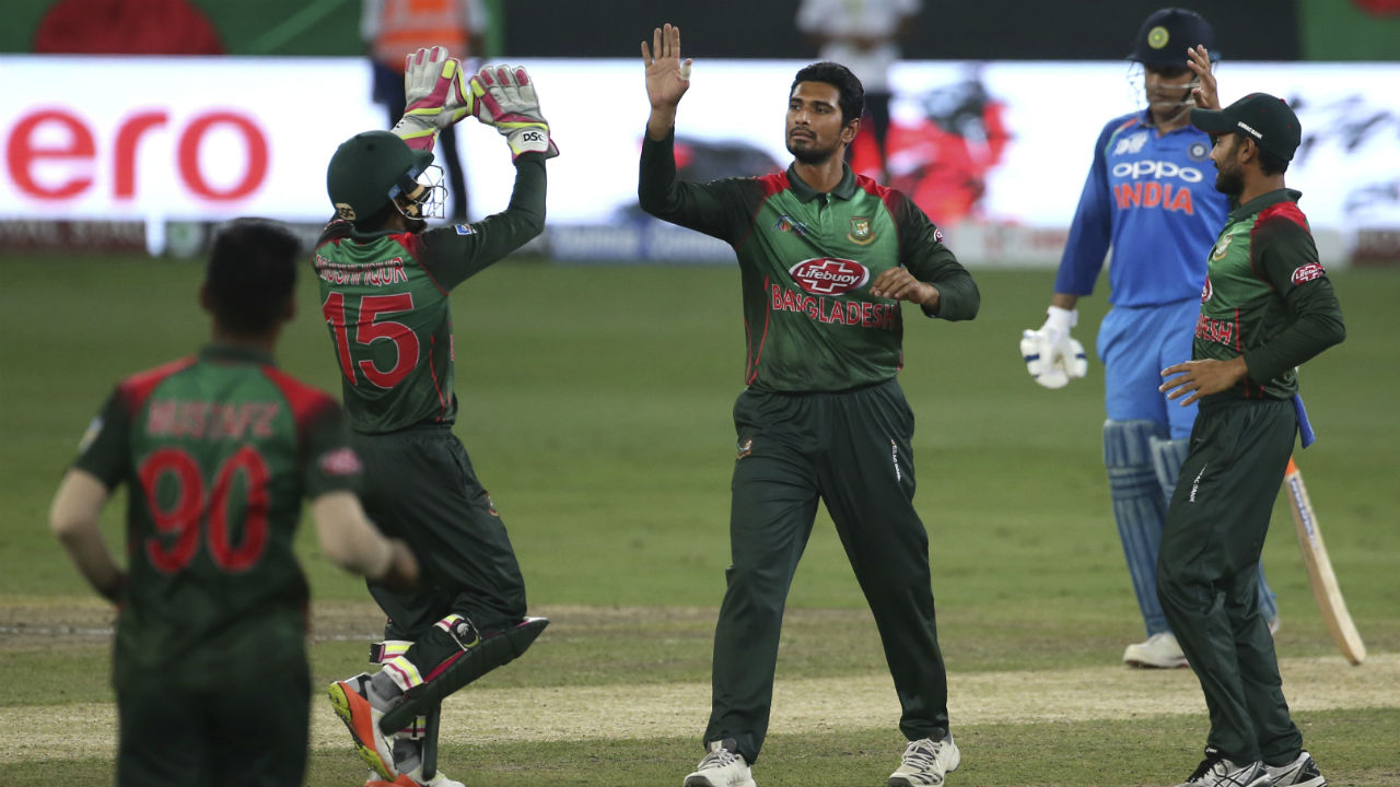 Mahmudullah then brought Bangladesh back into the game when he trapped Karthik in front of the wickets in 31st over. At fall of Karthik's wicket India's score read 137/4. (Image: AP)