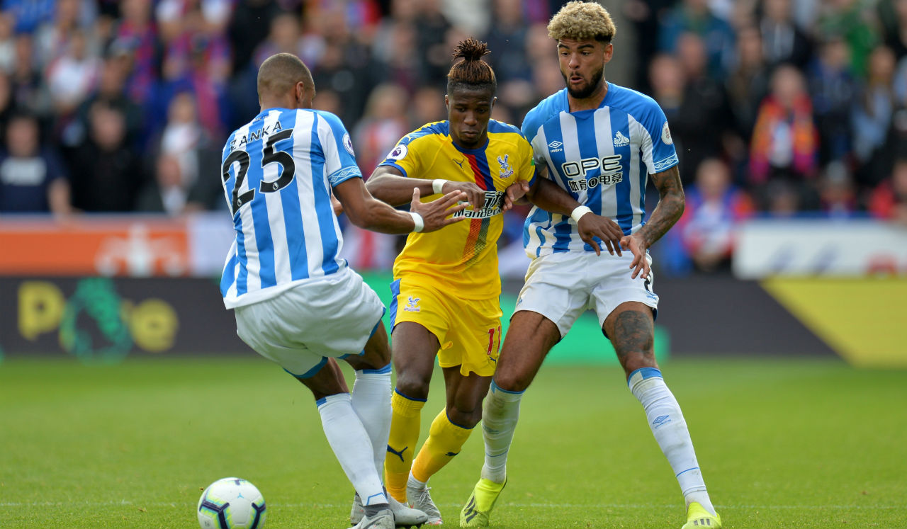 Huddersfield 0 – 1 Crystal Palace | Wilfried Zaha produced a moment of magic to help Crystal Palace record only their second win of the season as he made his return to the side following a groin injury. Zaha knocked the ball between two defenders before smashing it past Jonas Lossl in 38th minute to score the only goal of the game. (Image: Reuters)