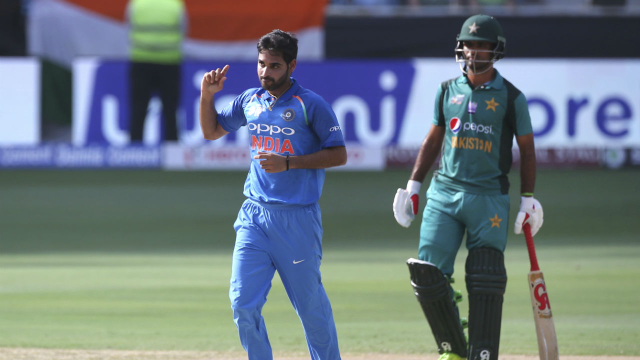 Indian bowler Bhuvneshwar Kumar gave the Men in Blue a great start as he dismissed Pakistan's openers Imam-ul-Haq and Fakhar Zaman inside the first five overs. After ten overs Pakistan's score read 25/2. (Image: AP)