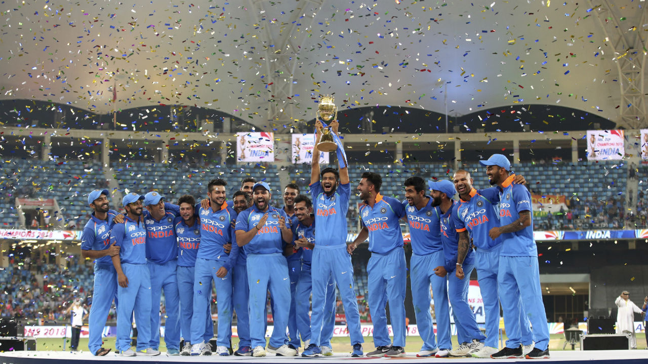 Men in Blue were all delighted as the team lifted the trophy at the Dubai International Cricket Stadium. (Image: AP)
