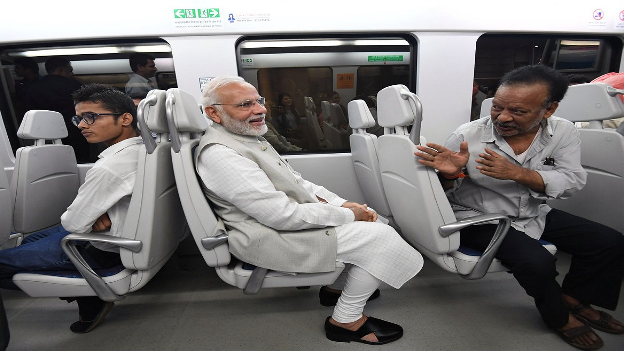 The PM travelled via the Airport Express Metro Line and reached the venue to lay the foundation stone of IICC. (Image: Press Information Bureau)