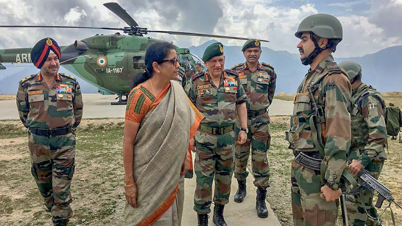 Defence Minister Nirmala Sitharaman with Army Chief Gen. Bipin Rawat interacts with troops of the 28 Inf Div on their visit to the Balbir forward post in Keran sector, Jammu & Kashmir. (Image: PTI)
