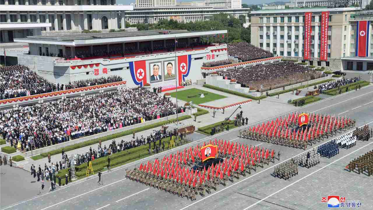 The parade held at Pyongyang's Kim Il Sung Square was attended by tens of thousands of North Koreans waving brightly coloured plastic bouquets. Kim Jong-un attended the morning parade but did not address the crowd. Dignitaries in attendance included the head of the Chinese parliament and delegations from allies of North Korea. (Image: Reuters)