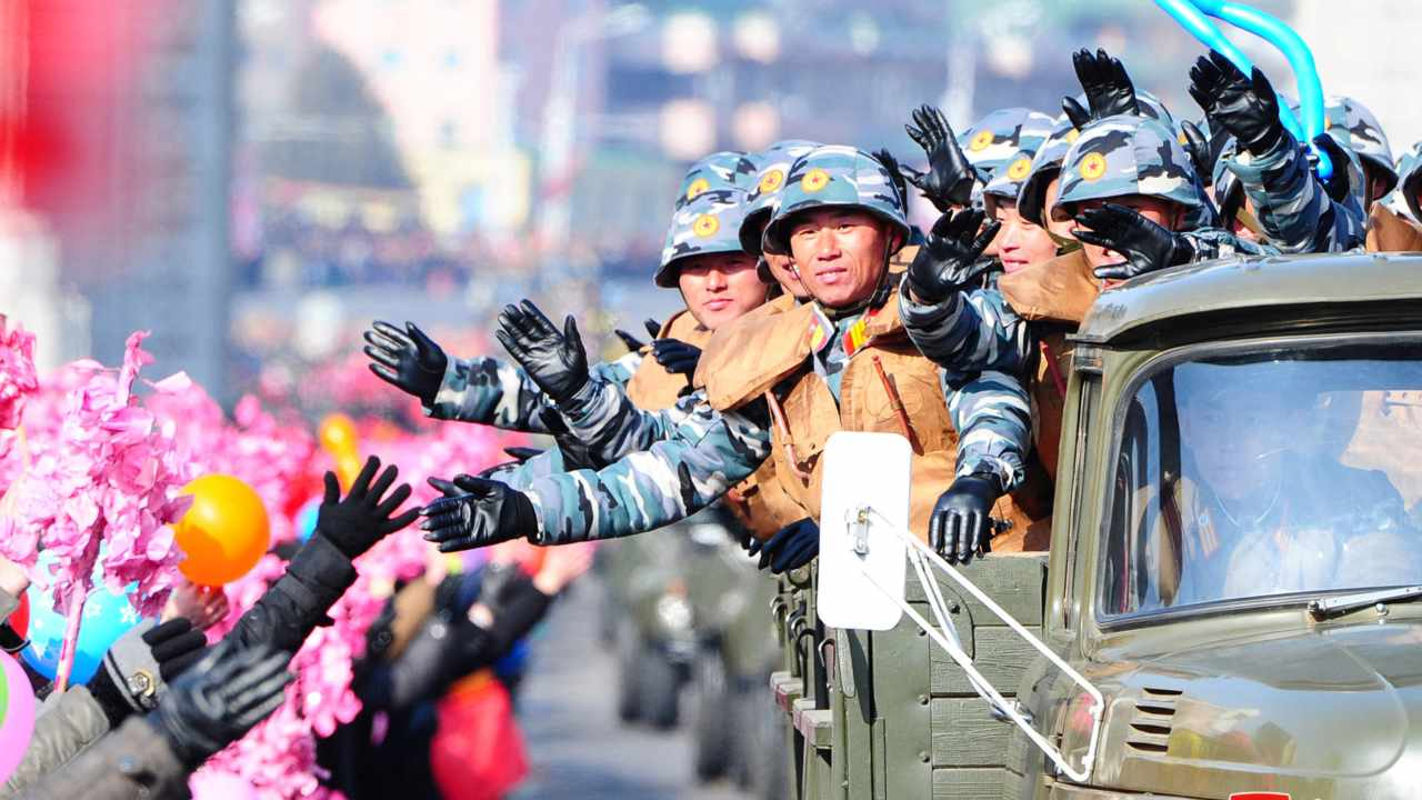 Residents of the capital, who were unable to witness the grandeur, lined the streets around Pyongyang to cheer convoys carrying troops after the conclusion of the parade. (Image: Reuters)