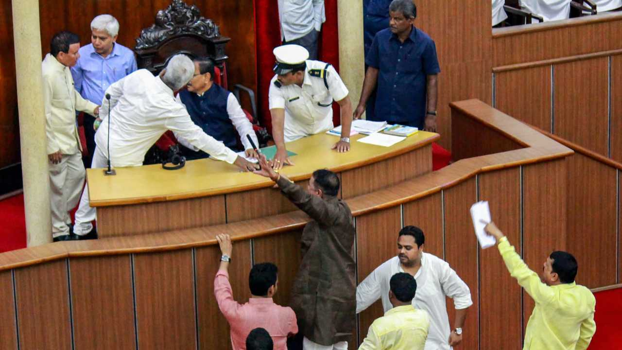 Congress MLAs shout slogans inside the well of the assembly against the fuel price hike, in Bhubaneswar. (Image: PTI)
