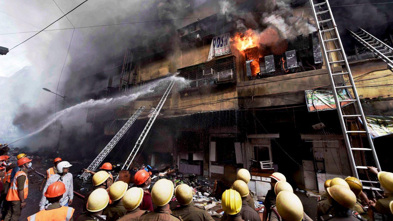 Firefighters try to douse a fire that broke out in a multi-storied wholesale Bagree market, at Burrabazar in Kolkata. (Image: PTI)