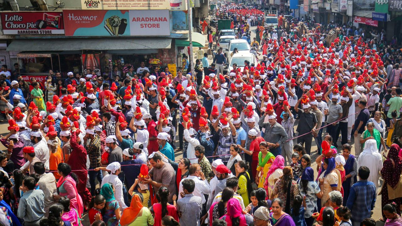Devotees carry clay water pots as they take part in a procession marking the end of 'Jhulelal Chaliha', a 40-day-long fasting festival of the Sindhi community, in Ahmedabad. (Image: PTI)