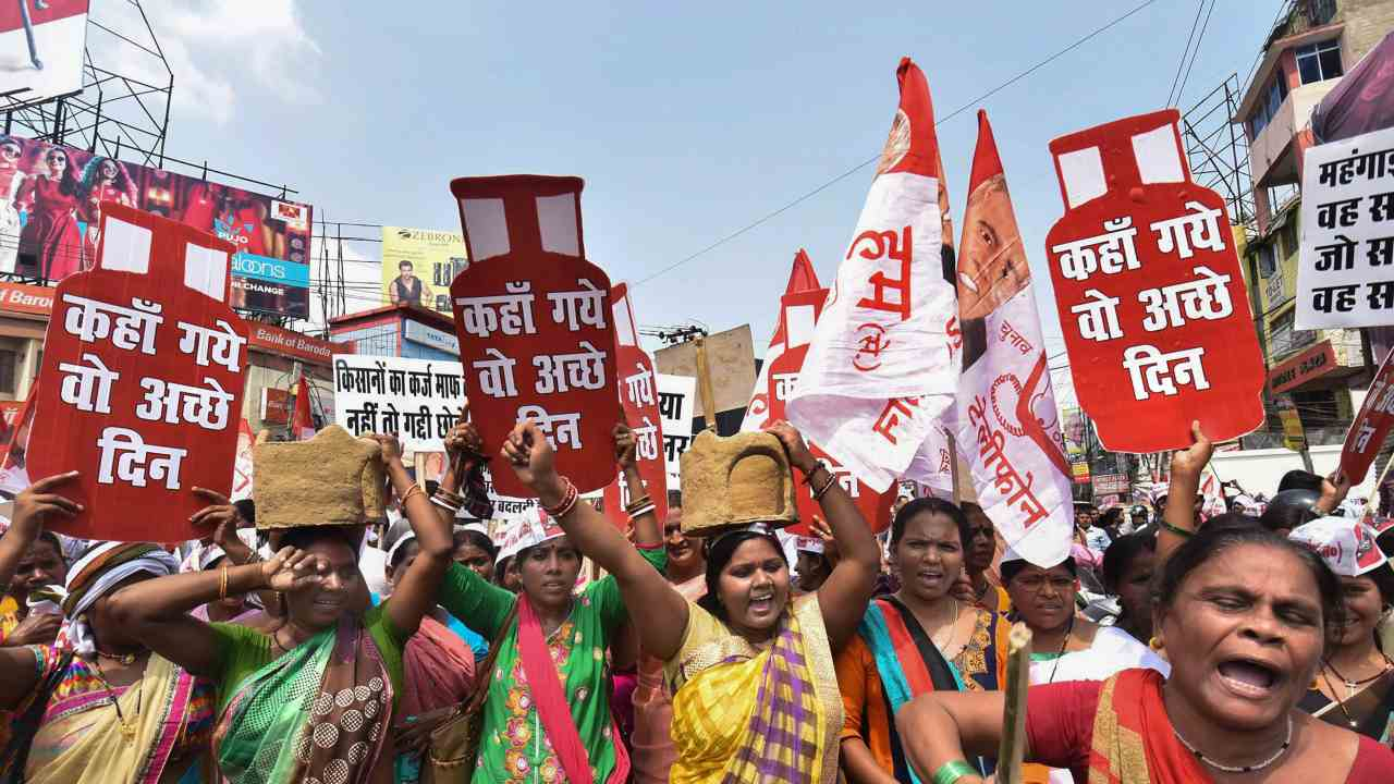Hindustani Awami Morcha activists stage a protest against fuel price hike and depreciation of the rupee, in Patna. (PTI)