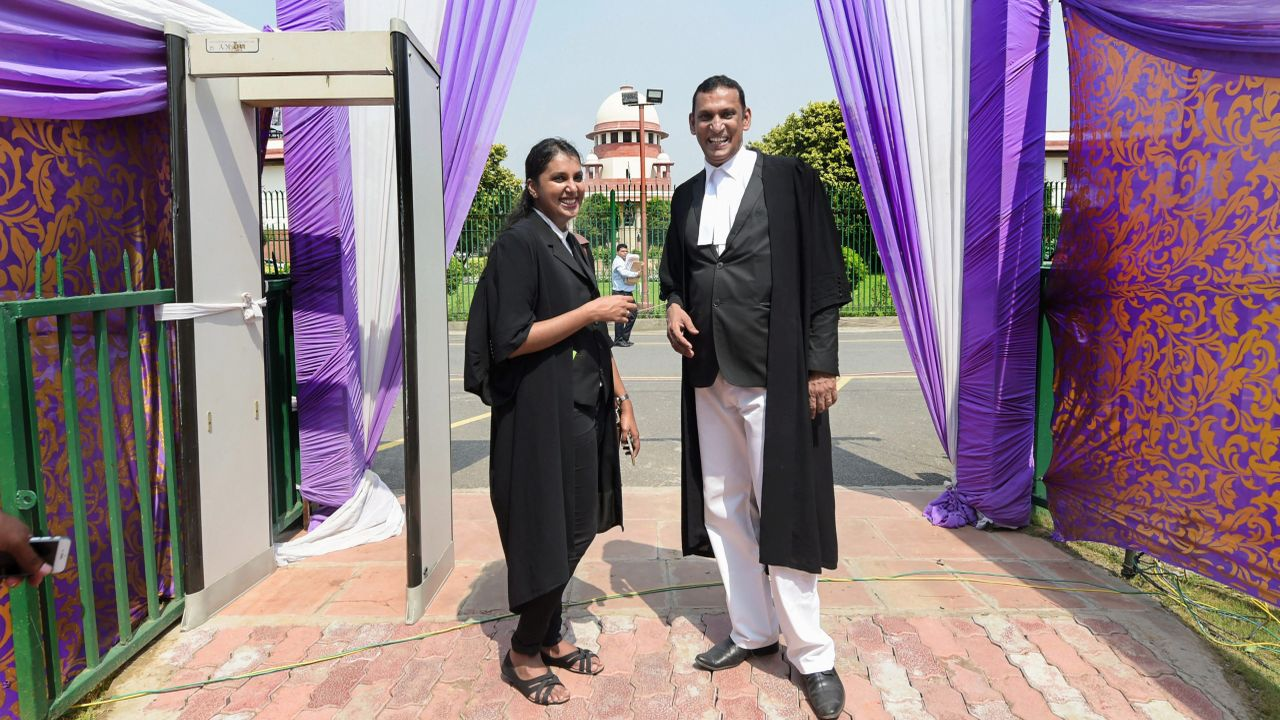 Lawyer Kaleeswaram Raj and Thulasi K Raj leave after the Supreme Court verdict on adultery law, in New Delhi. A five-judge constitution bench headed by Misra and consisting of justices RF Nariman, AM Khanwilkar, DY Chandrachud and Indu Malhotra gave a concurring verdict to declare adultery as unconstitutional. (PTI)