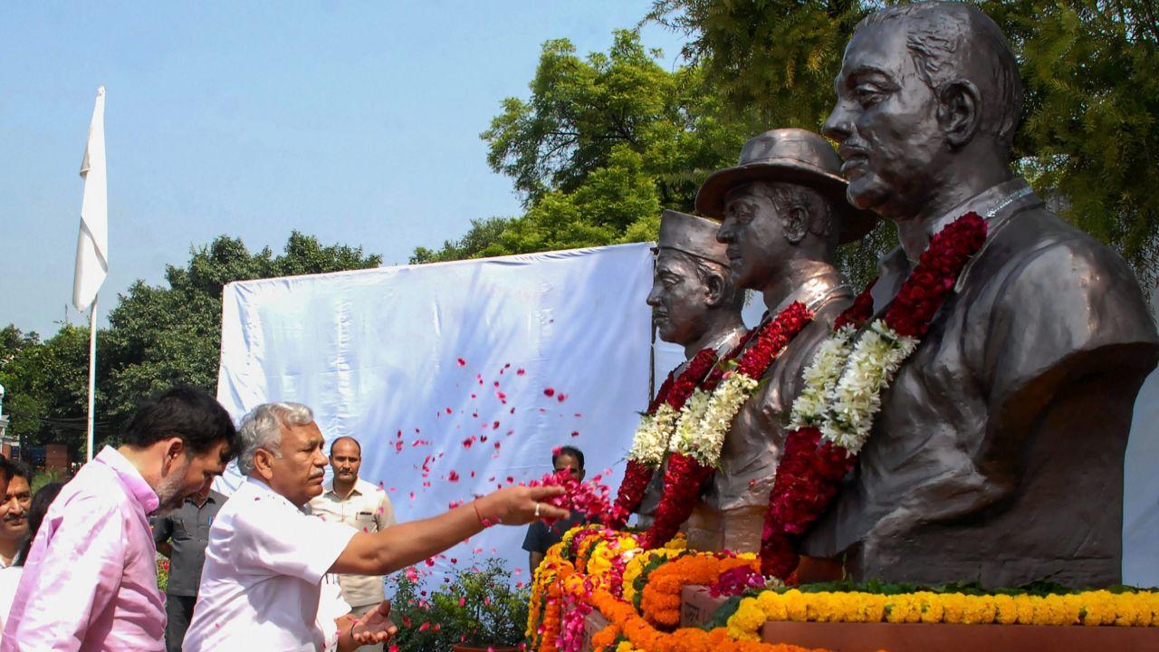 Delhi Assembly Speaker Ram Niwas Goel pays floral tribute to Vithal Bhai Jhaver Bhai Patel on his 145th birth anniversary and Shaheed Bhagat Singh on his 111th birth Anniversary, in New Delhi. (PTI)