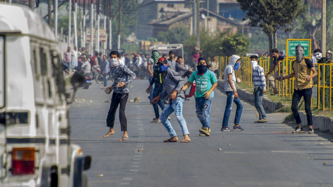 Protesters hurl stones on a police vehicle during a protest after a funeral procession of Mohammad Salim Malik, who was killed in a firing incident during a search operation, at Noorbagh, Srinagar. (PTI)