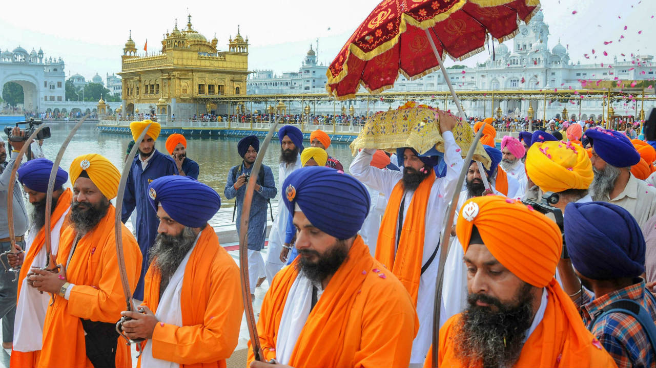 Panj Pyaras lead a Nagar Kirtan procession to mark the 357th birth anniversary of Sikh warrior Shaheed Baba Jiwan Singh, at Golden Temple in Amritsar. (Image: PTI)
