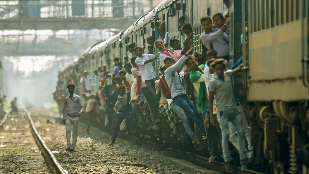 Passengers travel by an overcrowded train during Bharat Bandh, called over the recent amendment of the SC/ST Act, in Patna. (Image: PTI)