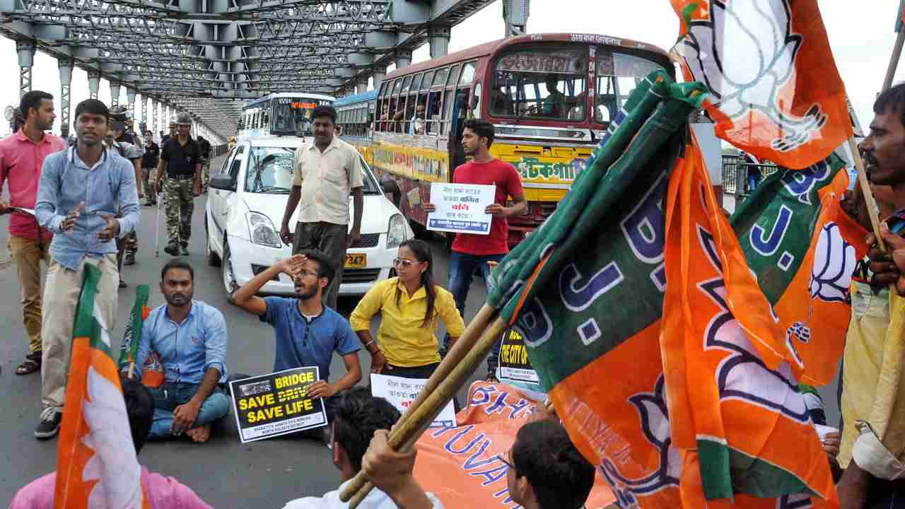 Members of Bharatiya Janata Yuva Morcha block the historic Howrah Bridge during a protest against Majerhat Bridge collapse incident and poor condition of many other bridges in the city, in Kolkata. (PTI)