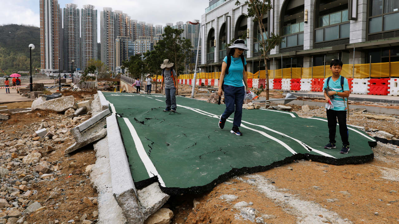 People walk through a damaged path after Super Typhoon Mangkhut hit Hong Kong, China. (Image: Reuters)