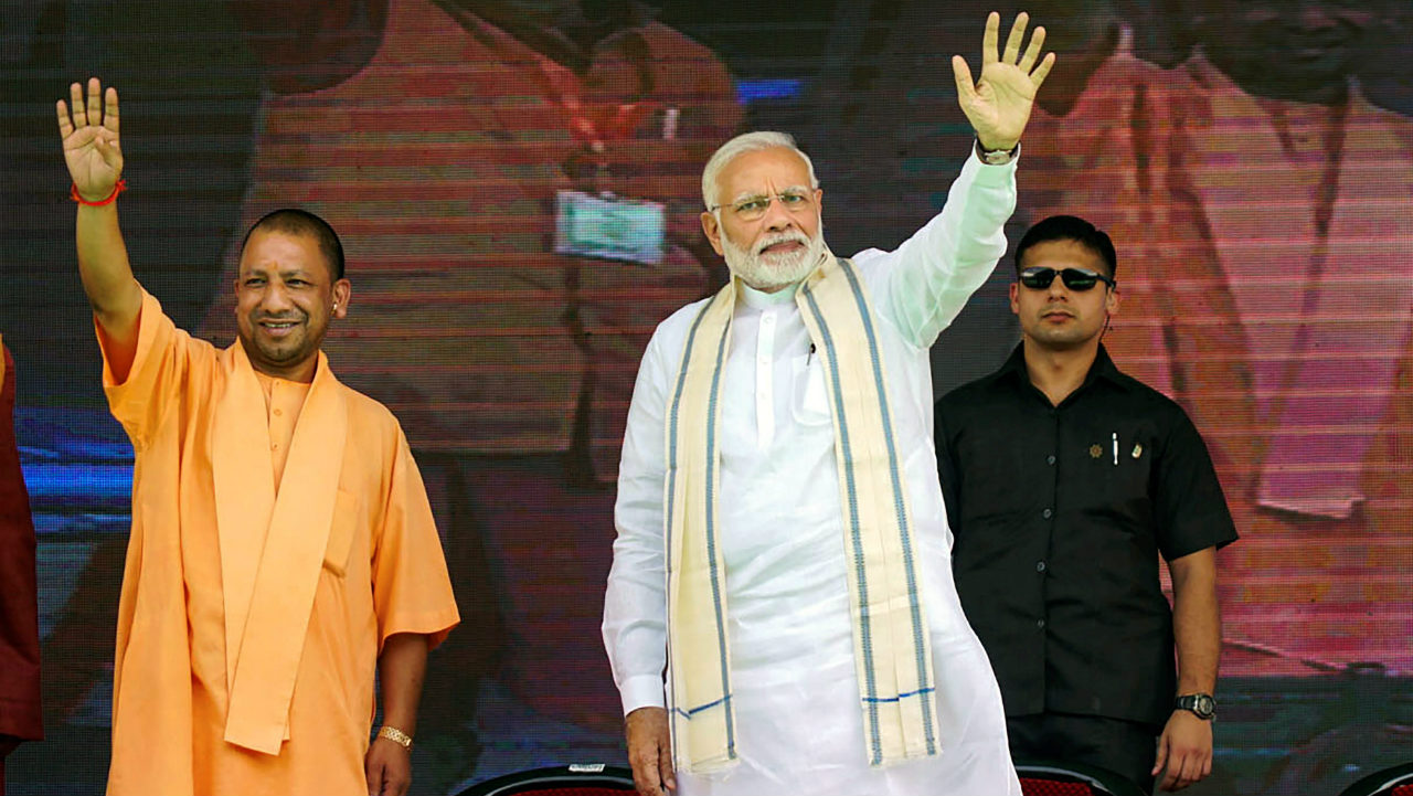 Prime Minister Narendra Modi and Uttar Pradesh Chief Minister Yogi Adityanath during a public meeting, in Varanasi, Uttar Pradesh. (Image: PTI)