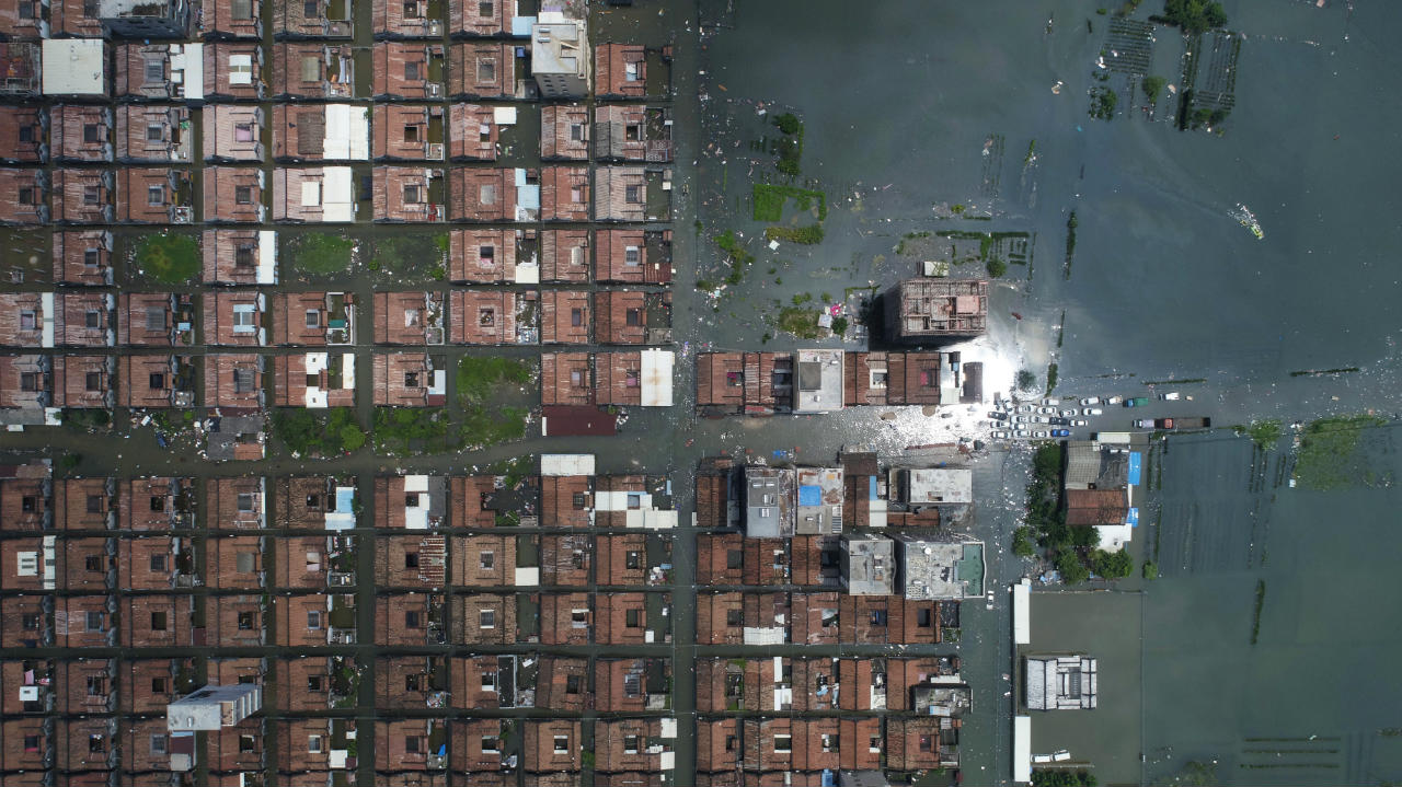 Residential houses submerged in floodwaters following heavy rainfall are seen at a town in Shantou, Guangdong province, China. (Image: Reuters)