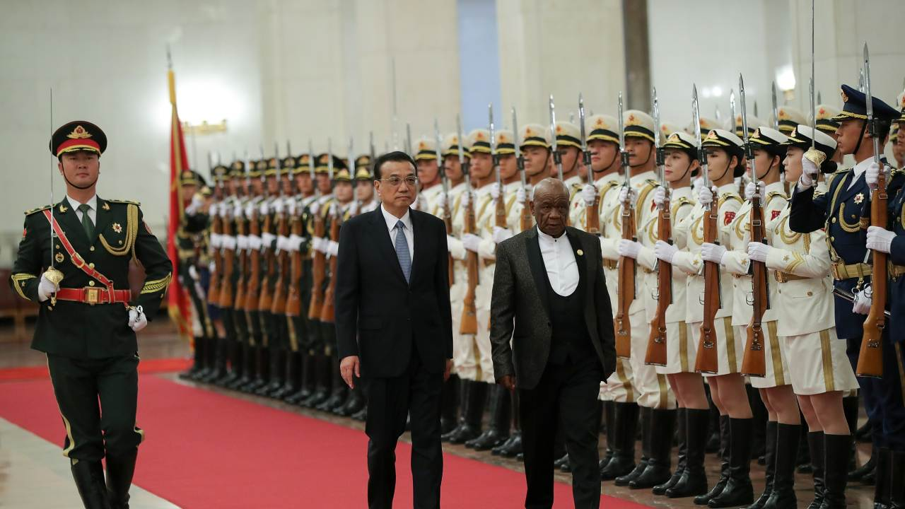 Chinese Premier Li Keqiang and Prime Minister of Lesotho, Thomas Motsoahae Thabane view an honour guard during a welcoming ceremony inside the Great Hall of the People in Beijing, China (Image: Reuters)