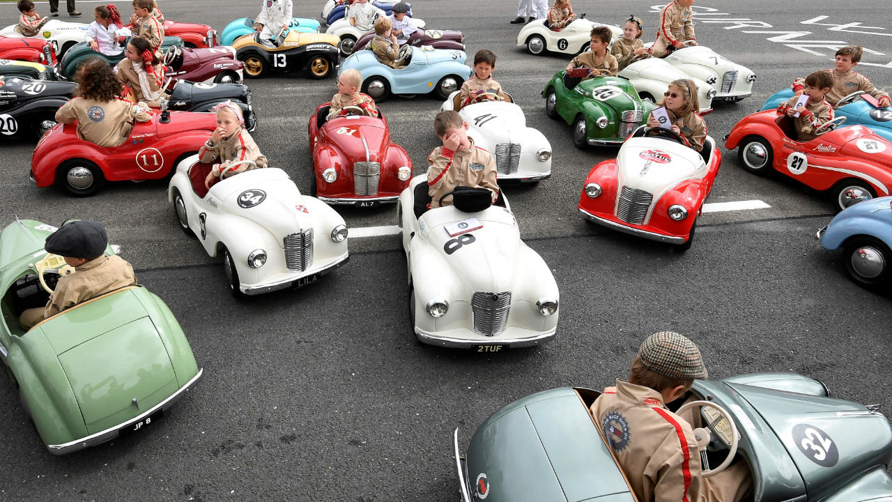 Children react after competing in a pedal car race as motoring enthusiasts attend the Goodwood Revival, a three day classic car racing festival celebrating the mid-twentieth century heyday of the sport, at Goodwood in United Kingdom. (Image: Reuters)