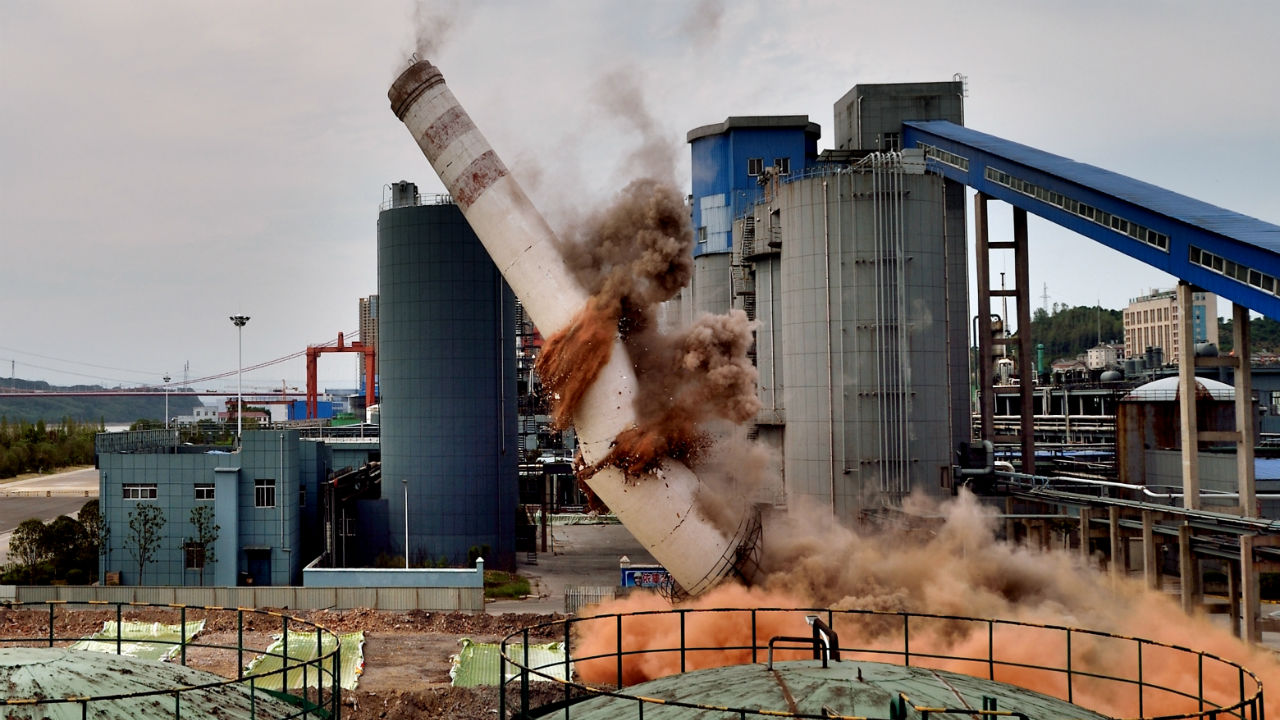 A chimney topples during a controlled demolition at a thermal power plant of Hubei Xingfa Chemicals Group in Yichang, Hubei province, China. (Image: Reuters)