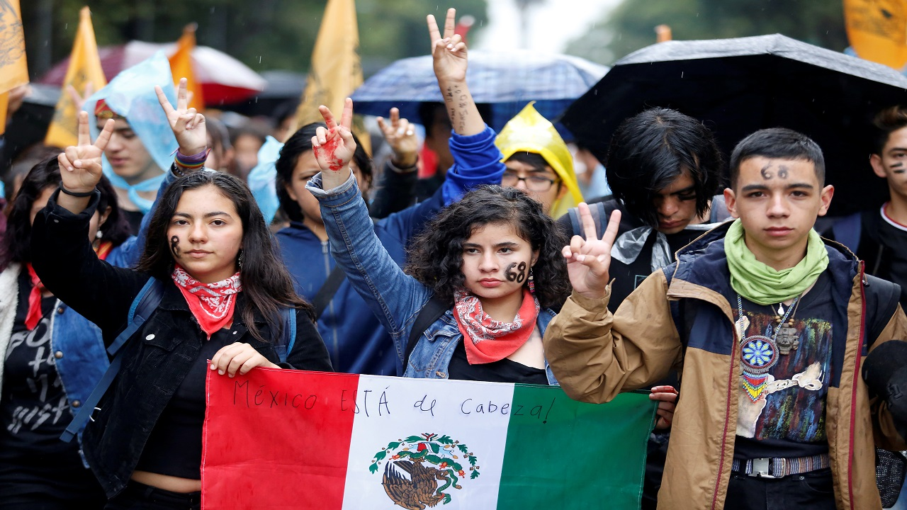 Students gesture during the 'March of Silence' to demand the end of violence against students of the National Autonomous University of Mexico (UNAM) in Mexico City. (Image:Reuters)
