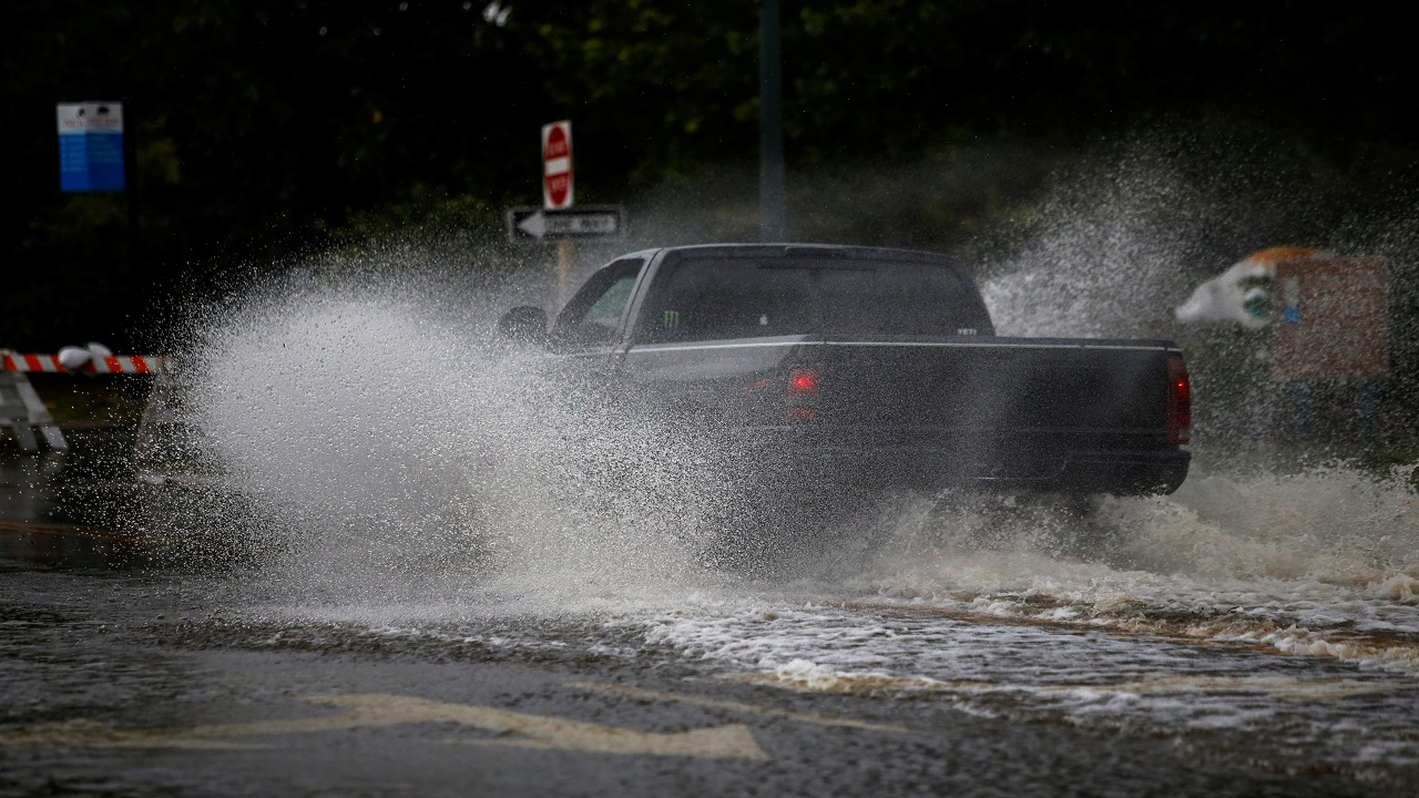 A man drives his vehicle around the Union Point Park Complex through floodwaters as the Hurricane Florence comes ashore in New Bern, North Carolina. (Image:Reuters)