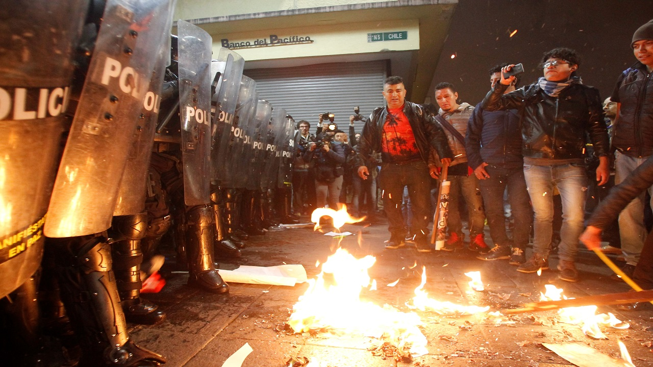 People throw burning newspapers to police during a protest against Ecuador's President Lenin Moreno's government in Quito, Ecuador. (Image:Reuters)