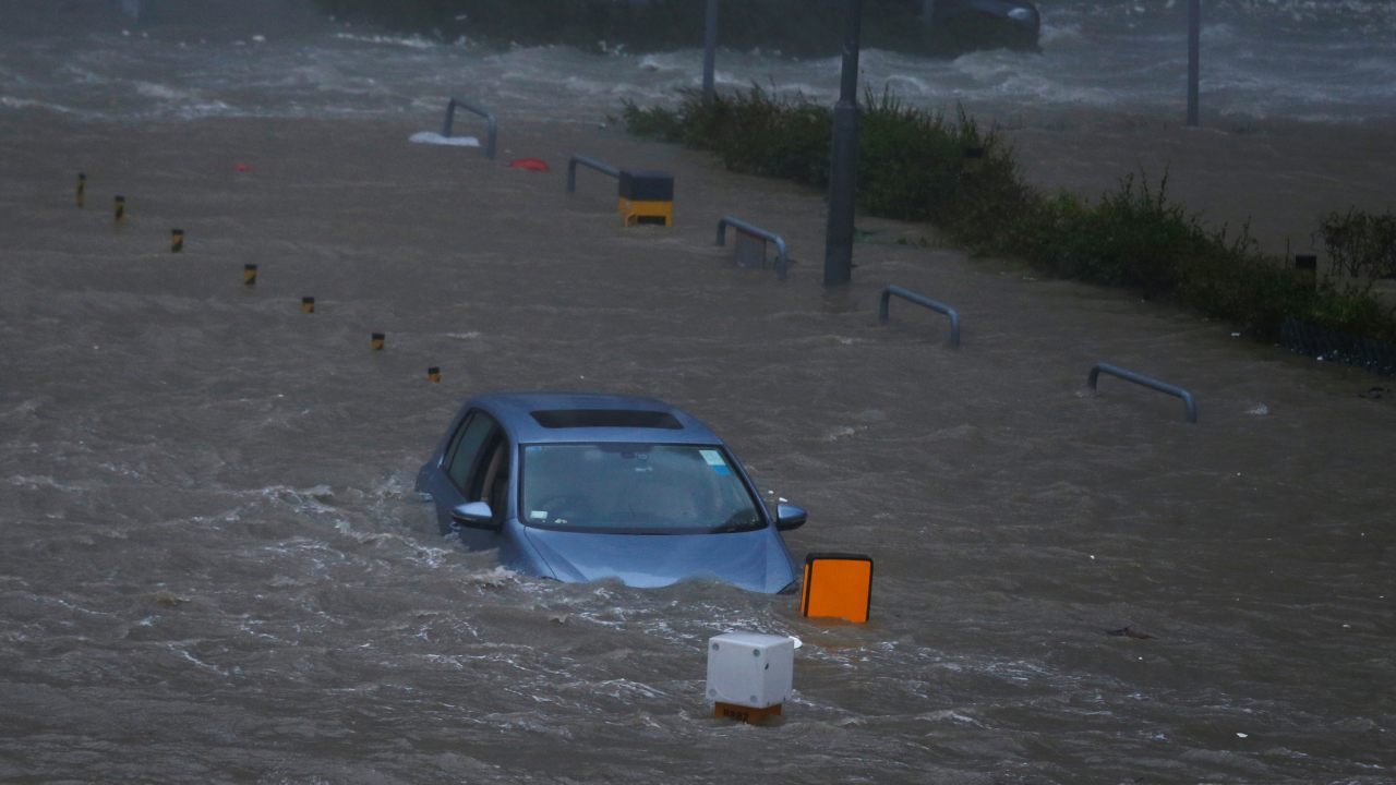 A car is stranded in seawater as high waves hit the shore at Heng Fa Chuen, a residential district near the waterfront, during Typhoon Mangkhut in Hong Kong, China. (Image: Reuters)