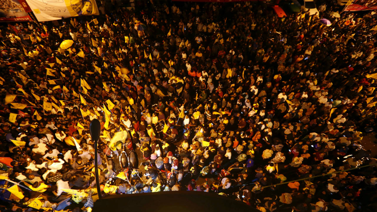 Supporters of Maldivian joint-opposition presidential candidate Ibrahim Mohamed Solih celebrate on a street at the end of the presidential election day in Male, Maldives. (Image: Reuters)