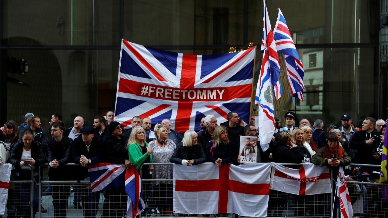 Supporters of former English Defence League leader Stephen Yaxley-Lennon, or 'Tommy Robinson', who was jailed for contempt of court in May and later released, wait for him to arrive at the Old Bailey to attend a court hearing, in London, Britain. (Reuters)