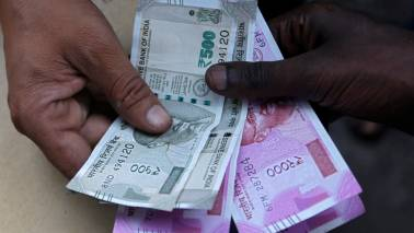 Rupee erases gains; trades lower at 68.99 per dollar