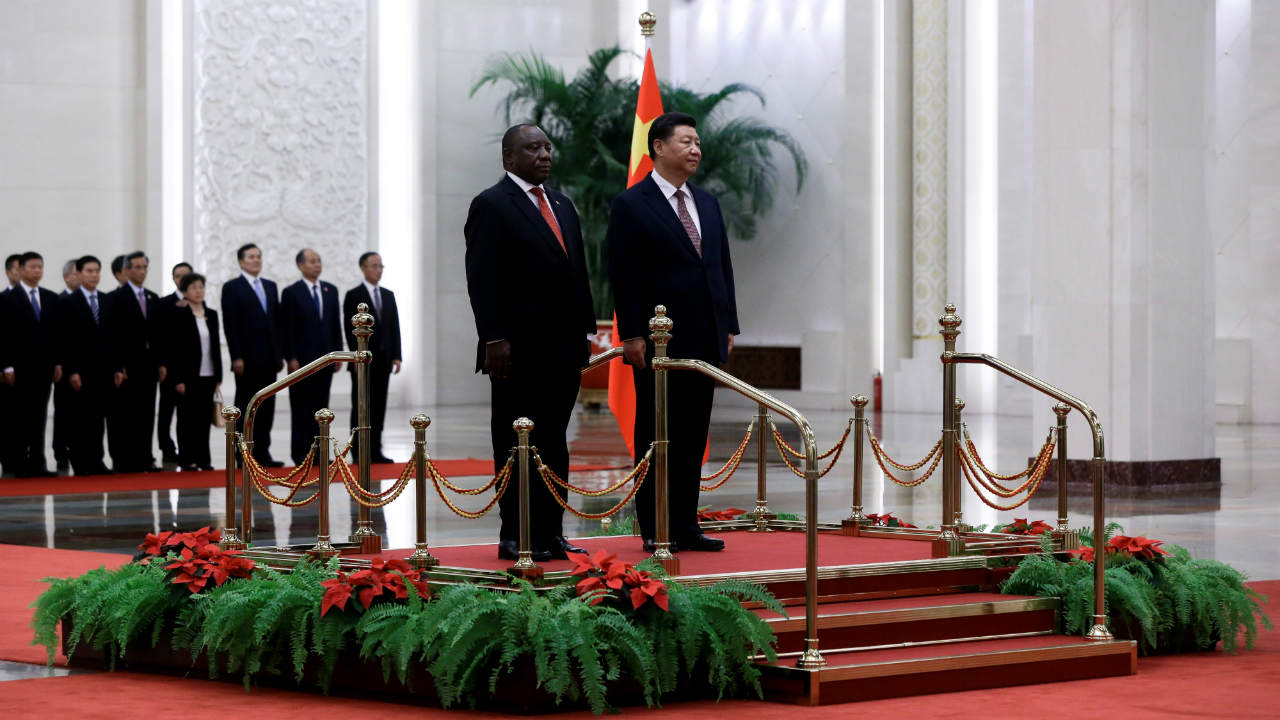 South Africa's President Cyril Ramaphosa and China's President Xi Jinping stand on the podium during a welcome ceremony at the Great Hall of the People in Beijing, China. (Image: Reuters)