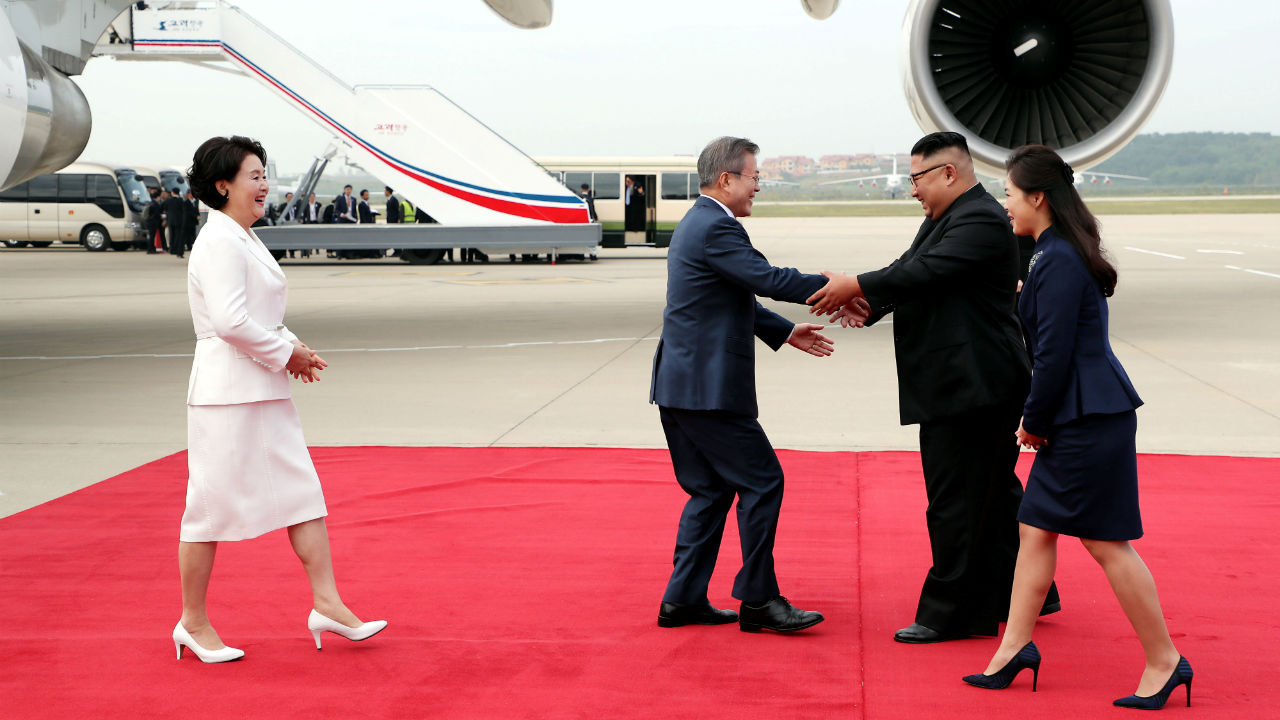 South Korean President Moon Jae-in is greeted by North Korean leader Kim Jong-un during an official welcome ceremony at Pyongyang Sunan International Airport, in Pyongyang, North Korea. (Image: Pyeongyang Press Corps/Pool via Reuters)