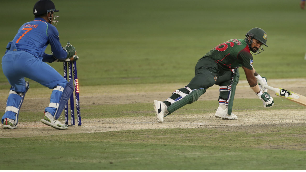 Liton Das was finally dismissed on 121 when a lightning fast M S Dhoni stumped the batsman off a Kuldeep Yadav googly. The wicket-keeper-bowler duo combined again to remove Mashrafe Mortaza in similar fashion in the 43rd over. At fall of Mortaza's wicket Bangladesh scorecard read 196/7 in 43 overs. (Image: AP)