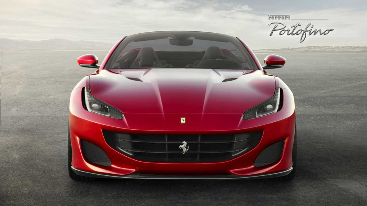 The car's front end is more sculpted with a large central grill and features distinct boomerang-shaped LED headlights with twin intakes on the front bumper. The front fenders have a vent and air fins, making it more aerodynamic. (Image credit: Ferrari)