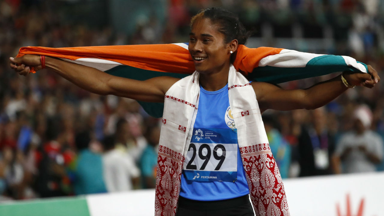 Hima Das (Women's 4x400m Relay, Mixed Relay, 400m) | 18-year-old Hima Das is the daughter of a rice farmer hailing from Dhing village in Assam. She started off by playing football with boys in mud pits next to the rice fields and was advised by a local coach to take up athletics. She was soon spotted during an inter-district meet and was asked to shift to Guwahati which is 140 km away from her home to pursue a future in athletics. At the 2018 Asian Games, Hima helped her team win the gold medal by giving them a blistering start in the women's 4x400m Relay. She also won silver medals in the Mixed Relay event and the 400m women's event. (Image - AP)
