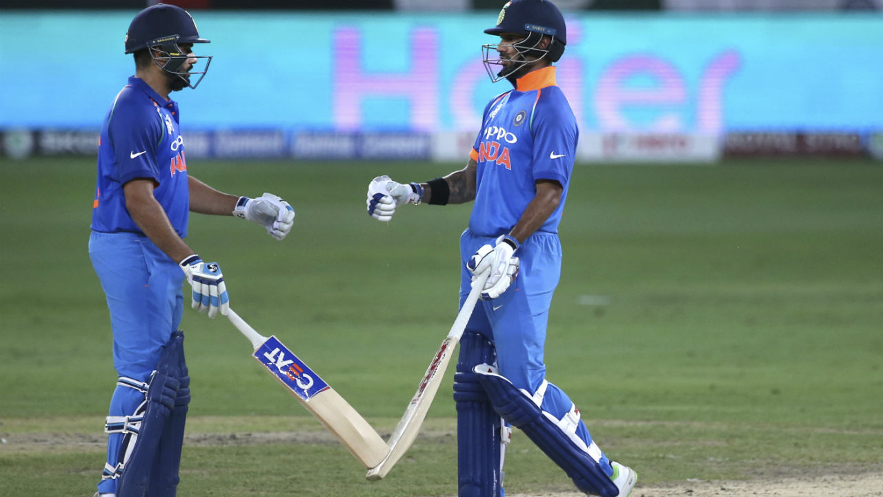 Sharma and Dhawan continued their excellent form in the Asia Cup as the two completed their respective fifties. Dhawan was the first of the two to reach the landmark when he played Shadab Khan for a boundary in the 18th over. Sharma soon followed as he scored two runs off Mohammad Amir in the 22nd over. (Image: AP)
