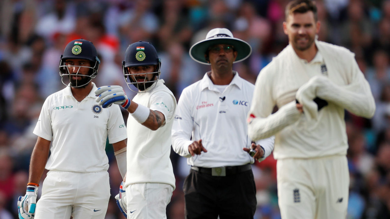 James Anderson had quite a few things to say to the umpire when he did not give Kohli out LBW in the 29th over. Kohli was not too pleased with that and the umpire had to get England's captain Joe Root to intervene and warn the bowler against further outbursts. (Image: Reuters)