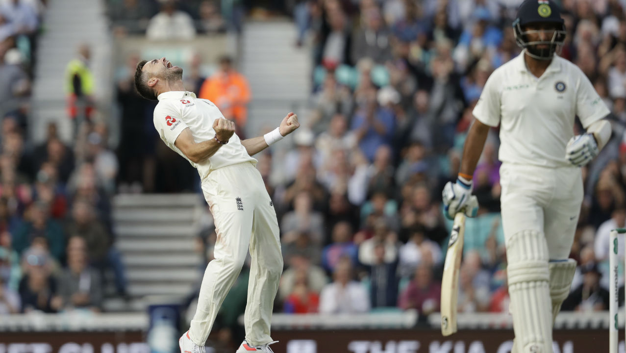 Anderson struck soon after his little outburst when he got Pujara to edge one back to Bairstow in the 33rd over. Rahane was the new man in and Anderson scalped him too in the 35th over, getting the batsman to edge one to Cook in the slips. This left India reeling at 103/4. (Image: AP)
