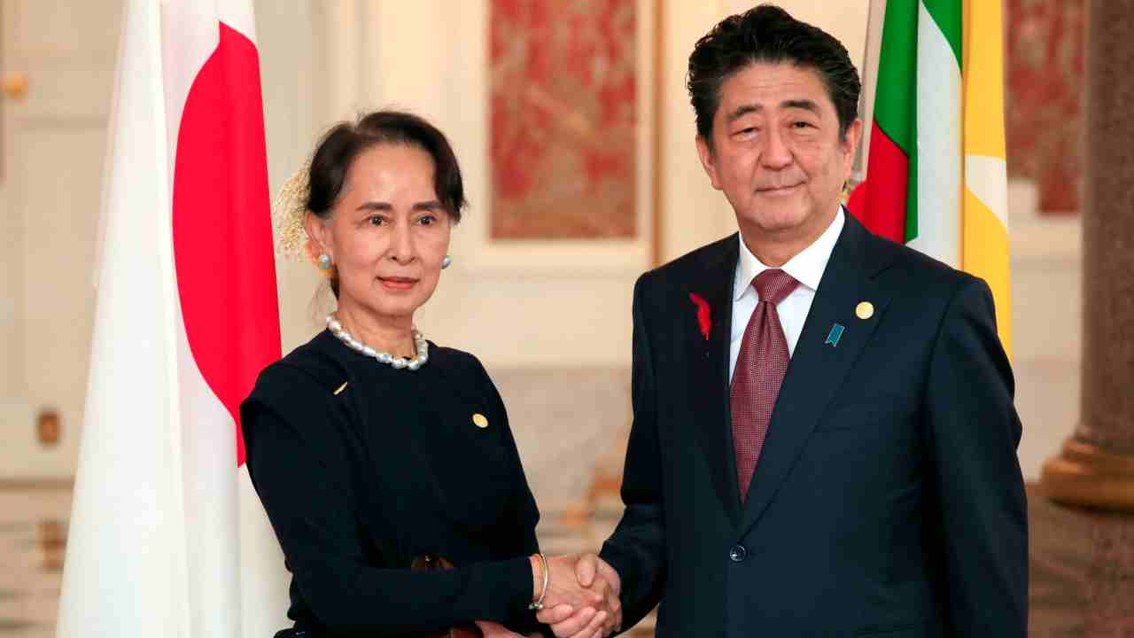 Japanese Prime Minister Shinzo Abe, right, shakes hands with Myanmar's State Counsellor Aung San Suu Kyi prior to the Japan-Mekong Summit Meeting at the Akasaka Palace State Guest House in Tokyo. (AP/PTI)