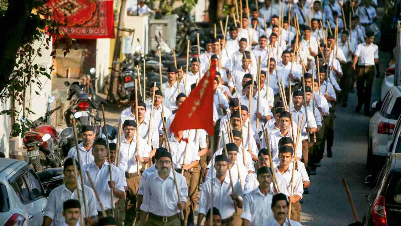 "Rashtriya Swayamsevak Sangh (RSS) volunteers participate in the ""Path-Sanchalan,"" or Route March to mark Vijaya Dashmi, or Dussehra celebrations, in Ahmedabad. (PTI)"