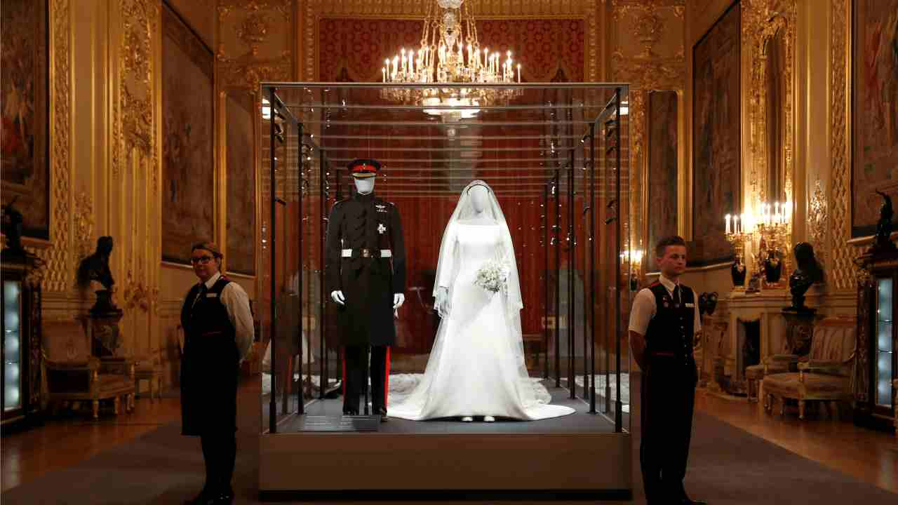 The wedding outfits of Meghan, Duchess of Sussex, and Harry, Duke of Sussex, are on display ahead of the exhibition A Royal Wedding, soon to open at Windsor Castle, in Windsor, Britain. (Reuters)