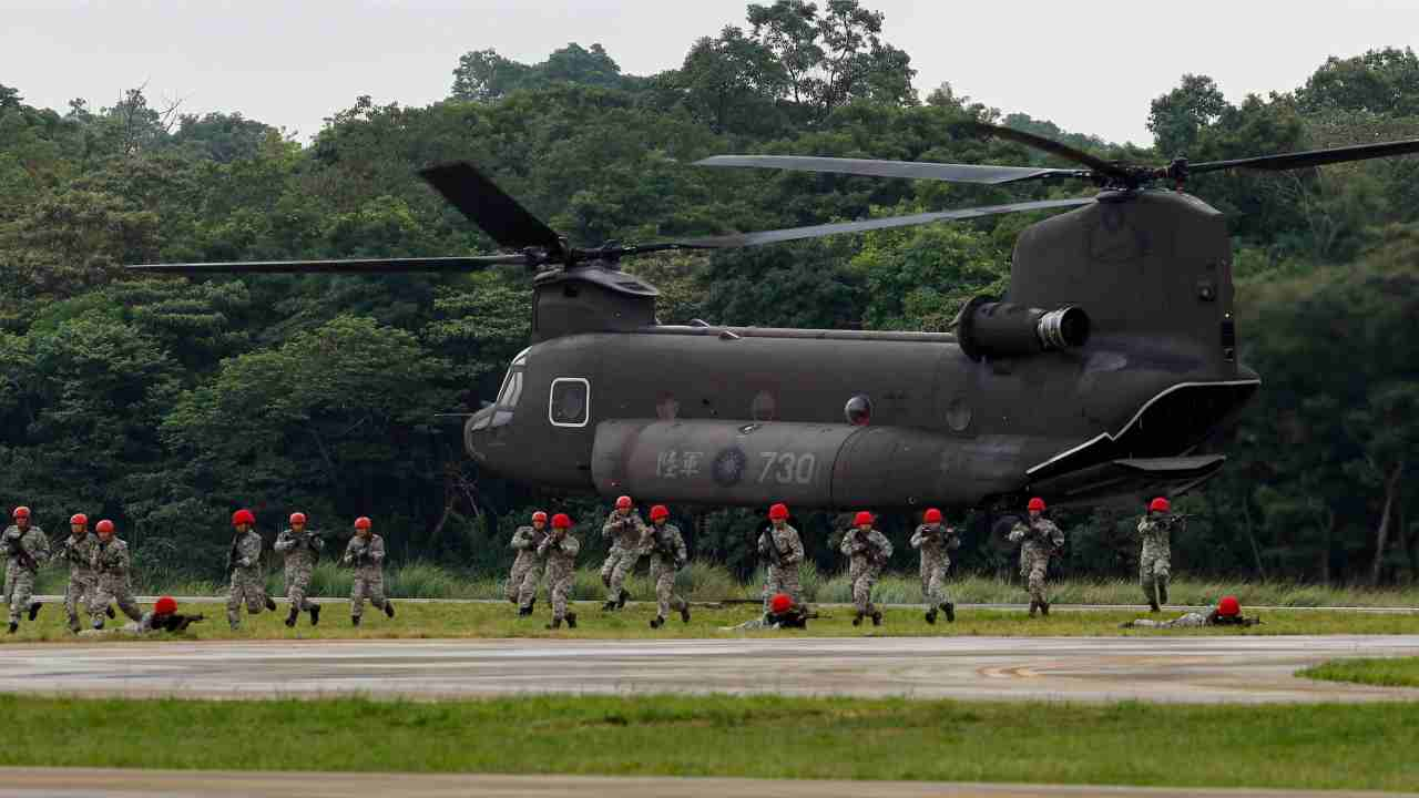 Fictitious enemy soldiers from Taiwan's special forces exit from a CH-47SD Chinook helicopter during a military drill in Taoyuan city, northern Taiwan. (AP/PTI)