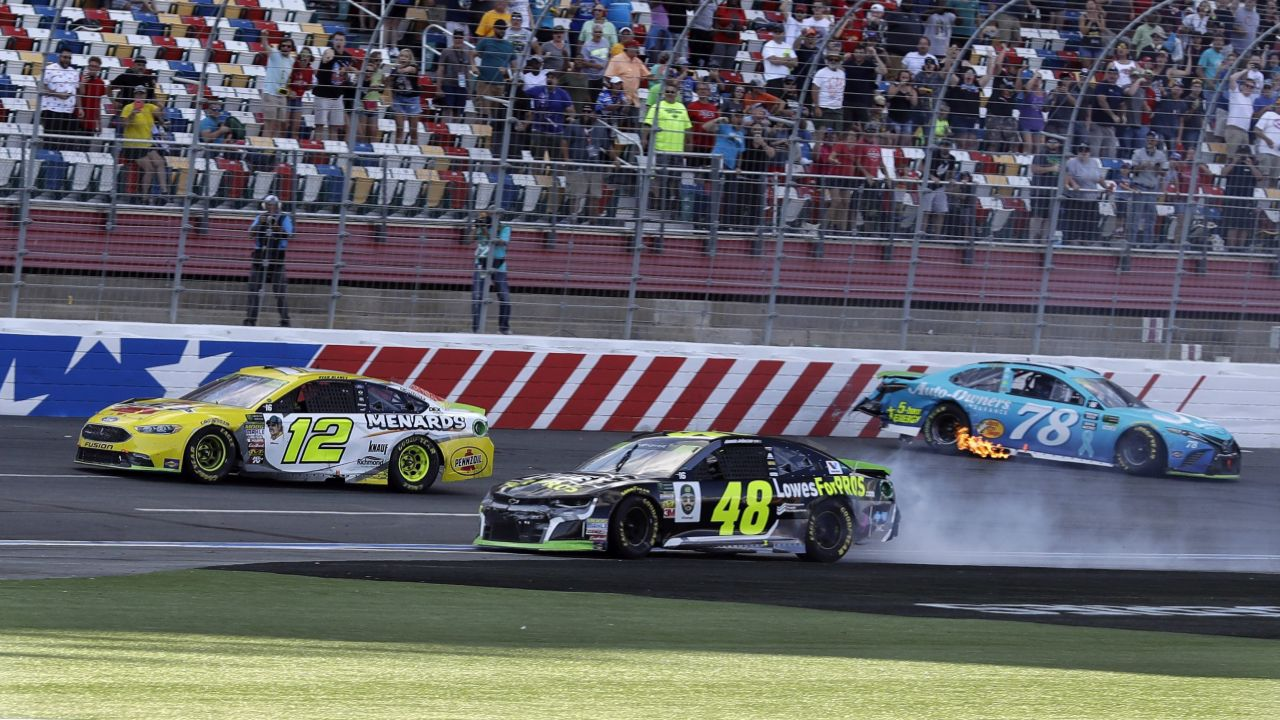 Ryan Blaney (12) drives past the wrecked cars of Jimmie Johnson (48) and Martin Truex Jr (78) to win the NASCAR Cup series auto race at Charlotte Motor Speedway in Concord. (AP/PTI)