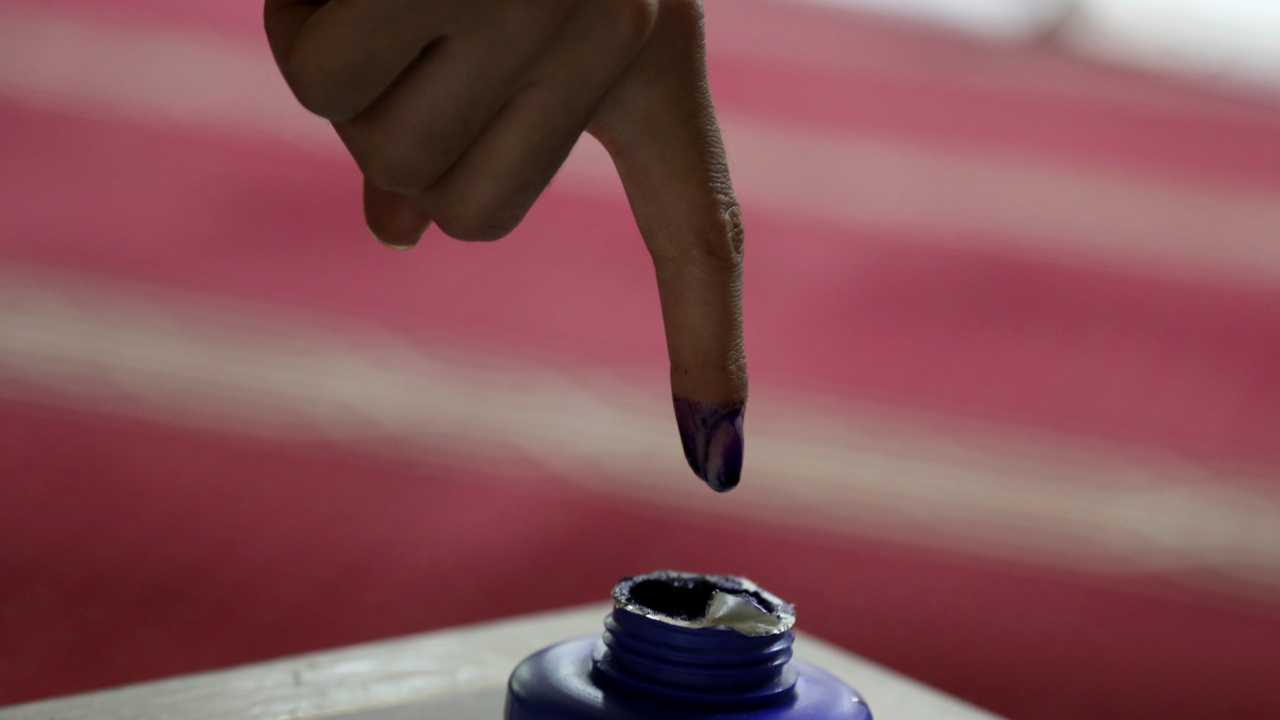 An Afghan woman inks her finger during the Parliamentary elections in Kabul, Afghanistan, on Saturday. Tens of thousands of Afghan forces fanned out across the country as voting began in the elections that followed a campaign marred by relentless violence. (Image: AP)