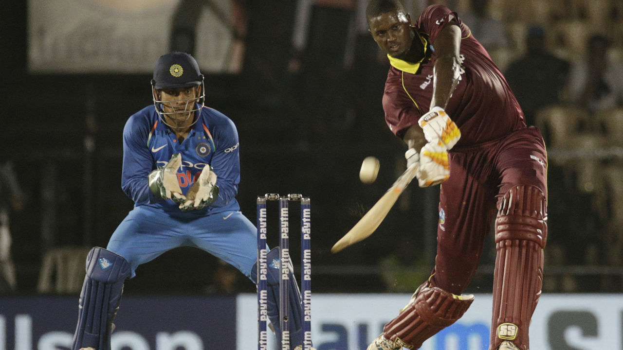 Jason Holder played a fighting innings as his teammates faltered around him. The Windies captain soon completed his 7th ODI fifty. Kuldeep Yadav picked up the last wicket of the Windies innings to bowl out the Calypsos for a paltry 153. India thus thumped Windies by 224 runs to go 2-1 up in the series. (Image: AP)