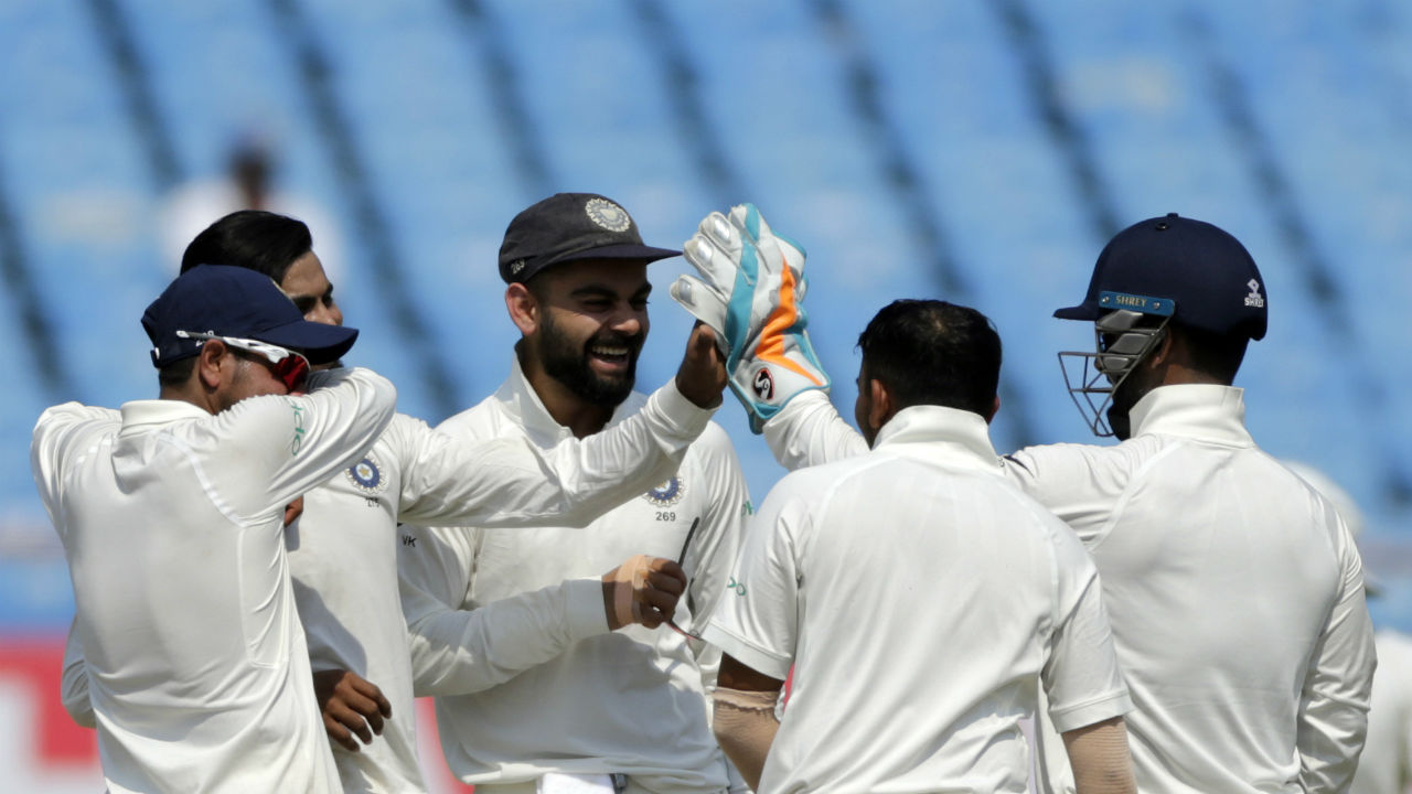 After bowling out West Indies for a paltry 181 runs in the first innings, India managed to keep a 468-run lead. India then enforced a follow-on and cleaned up the visitors for 196 runs to register an emphatic win by an innings and 272 runs. India thus have won all the seven Test in which they have taken a first-innings lead of 400-plus runs. (Image: AP)