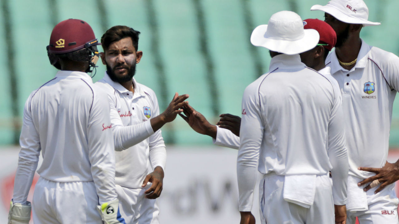 Devendra Bishoo then scalped the wickets of R. Ashwin and Kuldeep Yadav to take his wicket tally in the innings to four. At fall of Yadav's wicket India's score read 571/8. (Image: AP)